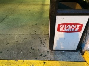 Pressure washing Giant Eagle before cleaning all the gum.