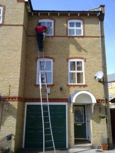 Ladder skills 101 - is this ladder on a flat surface, should it be twisted like this?